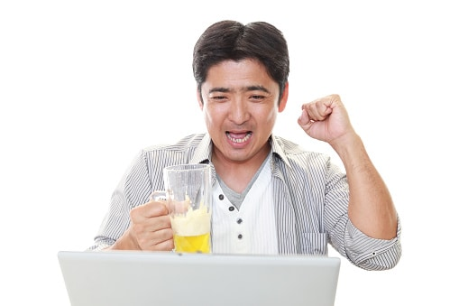 Man Drinking Beer at Laptop
