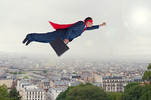 Super Lawyer with cape flying over city