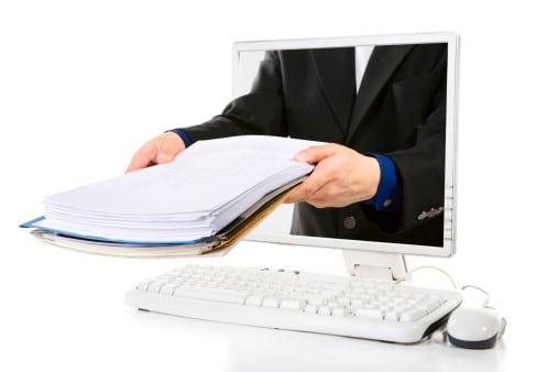 Practice Management Software - Hands with File Folders in Computer Screen